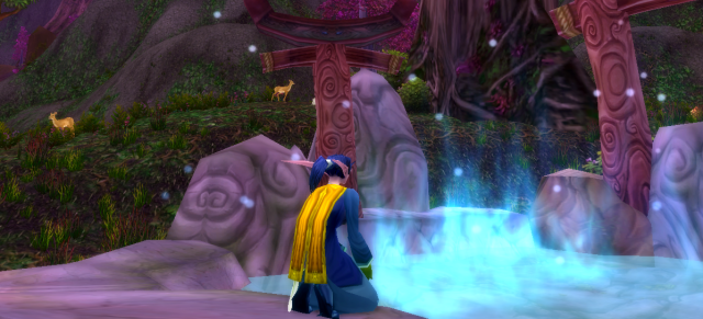 Yvois filling a phial at a moonwell